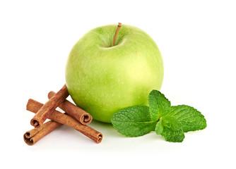 Green apple, cinnamon sticks and mint leaves