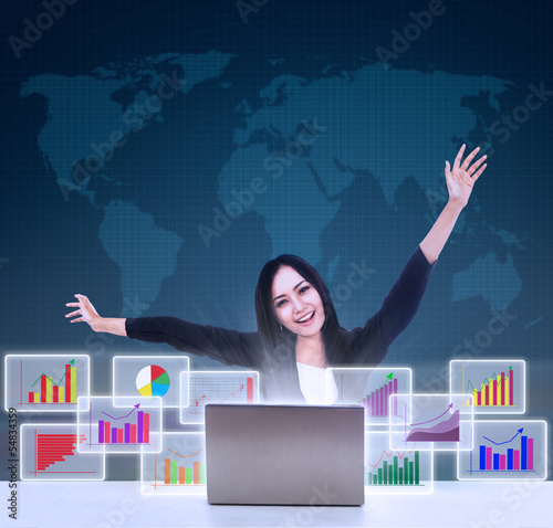 Happy businesswoman with bar graphs