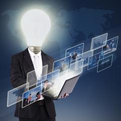Lightbulb head person with digital photos on blue