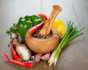 Spices, wooden mortar and vegetables