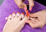 woman foot nail polishing in salon