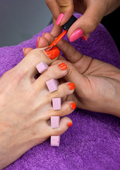 woman foot in nail polishing