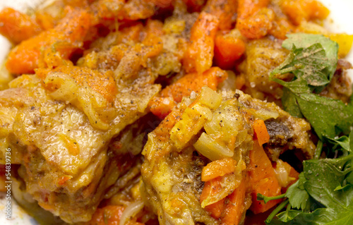chicken stew with potatoes, carrots, tomato sauce, onions.