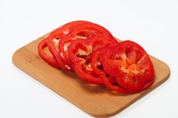 Sliced red pepper isolated on white background