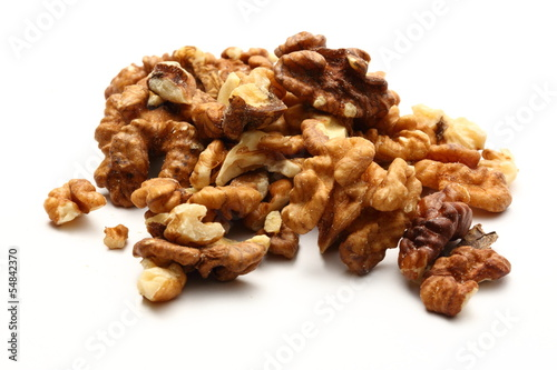 Heap of walnuts on white background