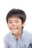 asian boy with painted face and smiling