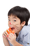 handsome asian boy eating a toy crab