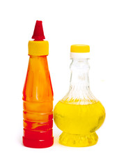 Bottle with vegetable oil and ketchup red on a white background