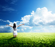 happy young woman in white dress standing in field