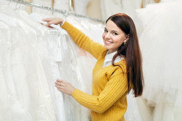 Girl chooses wedding outfit