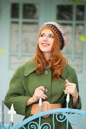 Redhead girl in vintage coat