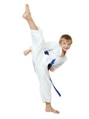 Boy athlete in a kimono performs a kick leg circular insulated