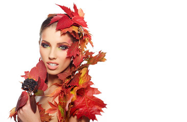 Beautiful woman with autumn leaves on whiite background