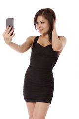 Young woman in a little black dress poses for a picture.