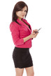 Beautiful woman in business outfit looks up while texting.
