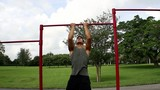 Front view. handsome athletic guy pulls on the bar. Pull ups