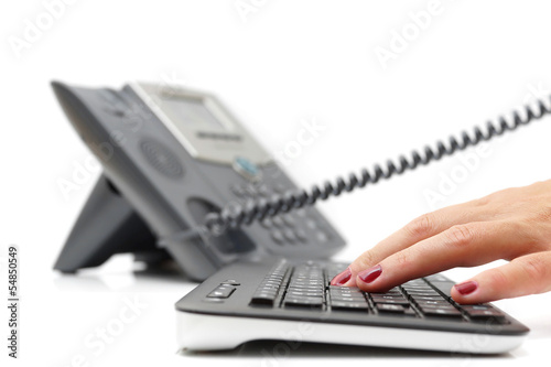 customer support concept with telephone and keyboard