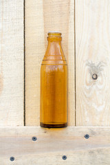 glass bottle on wooden background