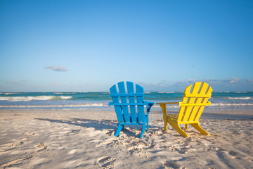 Beach wooden colorful chairs for vacations on tropical beach in