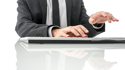 Typing on computer keyboard on white office desk
