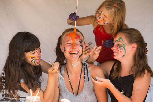 Four girls playing with painting