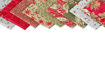 Quilting fabrics in different colors and patterns over white