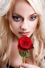 beautiful sexy blond woman with red rose.