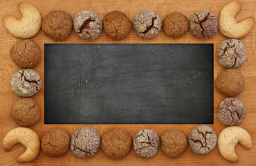 Blank Blackboard, Chalkboard, wooden frame and cookies, copy spa