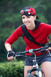 Portrait of young sports woman on bicycle