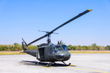 Military helicopter (huey) at a base