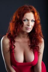Portrait of sexual busty woman posing in studio