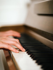 Female hands and piano keyboard