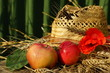 rural composition with apples, wheat and straw hat