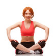 smiling woman sitting in lotus pose