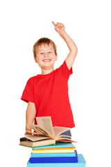 Happy little boy with books