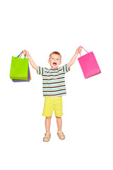 Happy little boy with shopping bags.