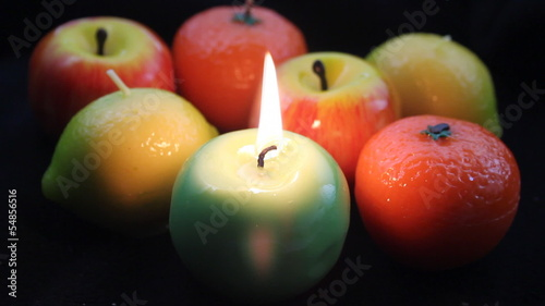 colorful fruit candle burning in dark