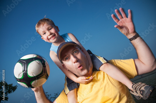 Father with son playing foot ball soccer