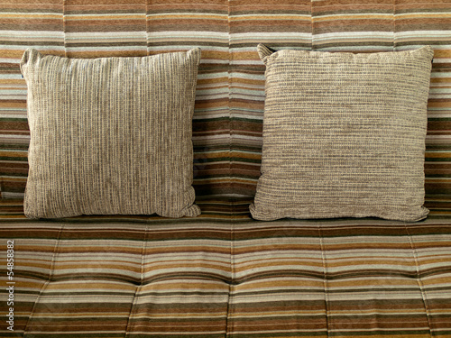 Pillow with brown fabric cover