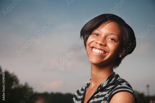 Happy African American teenage girl smiling