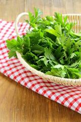 Fresh green parsley in wicker basket