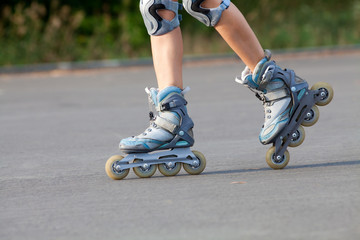 roller skates on beautiful girl's feet