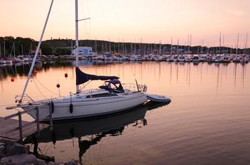 Sailboat harbor at sunset
