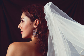 Young bride on black background