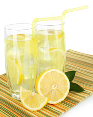 Delicious lemonade on table on white background