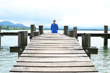 Girl on the wooden jetty