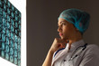 Woman doctor examining x-ray