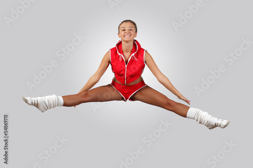 Young female dancer against white background