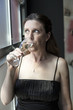 Middle Aged Woman in Black Dress with Champagne