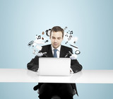 man working on notebook
